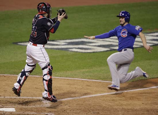 <div class='meta'><div class='origin-logo' data-origin='AP'></div><span class='caption-text' data-credit='AP'>Chicago Cubs' Kris Bryant slides home and scores as Cleveland Indians catcher Roberto Perez looks to make the tag during the fourth inning of Game 7. (AP Photo/Gene J. Puskar)</span></div>