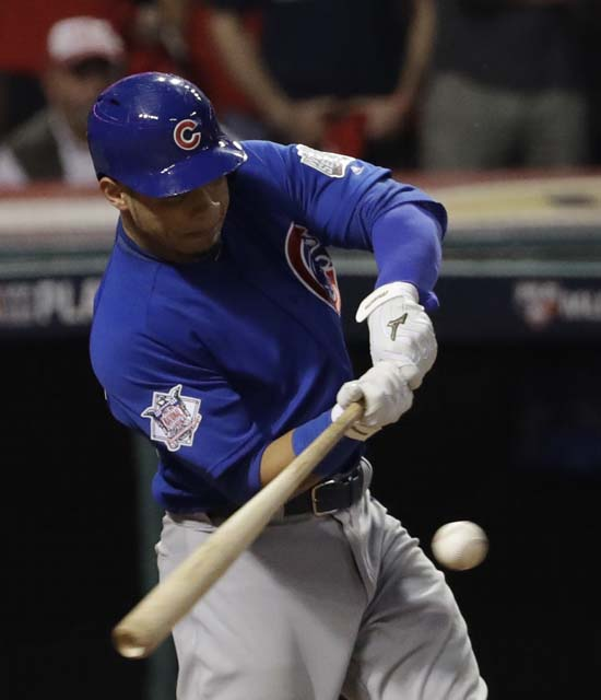 <div class='meta'><div class='origin-logo' data-origin='AP'></div><span class='caption-text' data-credit='AP'>Chicago Cubs' Willson Contreras hits an RBI double during the fourth inning of Game 7. (AP Photo/David J. Phillip)</span></div>