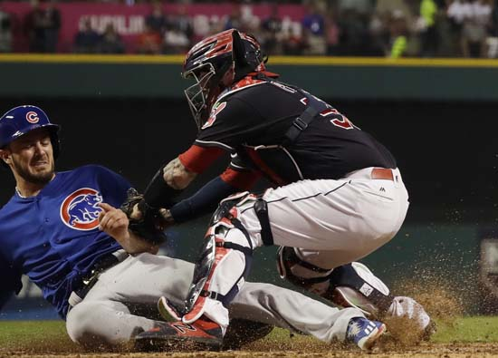 <div class='meta'><div class='origin-logo' data-origin='AP'></div><span class='caption-text' data-credit='AP'>Chicago Cubs' Kris Bryant is safe at home as Cleveland Indians catcher Roberto Perez puts on a late tag during the fourth inning of Game 7. (AP Photo/Tim Donnelly)</span></div>