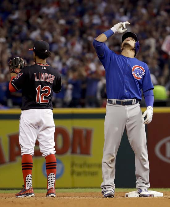 <div class='meta'><div class='origin-logo' data-origin='AP'></div><span class='caption-text' data-credit='AP'>Chicago Cubs' Willson Contreras celebrates after a RBI double against the Cleveland Indians during the fourth inning of Game 7. (AP Photo/Matt Slocum)</span></div>