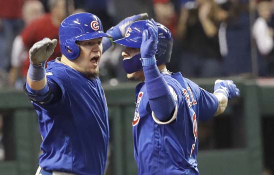 <div class='meta'><div class='origin-logo' data-origin='AP'></div><span class='caption-text' data-credit='AP'>Chicago Cubs' Javier Baez celebrates his home run with Kyle Schwarber during the fifth inning of Game 7 of the Major League Baseball World Series. (AP Photo/David J. Phillip)</span></div>