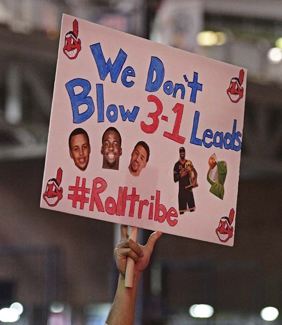 <div class='meta'><div class='origin-logo' data-origin='AP'></div><span class='caption-text' data-credit='AP'>A Cleveland Indians fan holds a sign during a watch party for Game 7 of the baseball World Series between the Indians and the Chicago Cubs. (AP Photo/David Dermer)</span></div>
