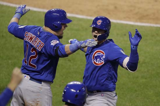 <div class='meta'><div class='origin-logo' data-origin='AP'></div><span class='caption-text' data-credit='AP'>Chicago Cubs' Javier Baez celebrates his home run with Kyle Schwarber during the fifth inning of Game 7 of the Major League Baseball World Series. (AP Photo/Gene J. Puskar)</span></div>
