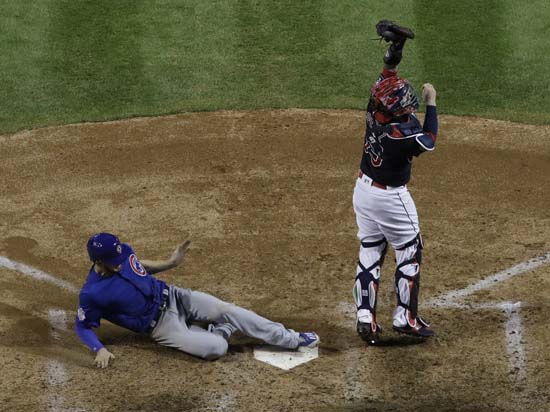<div class='meta'><div class='origin-logo' data-origin='AP'></div><span class='caption-text' data-credit='AP'>Chicago Cubs' Kris Bryant scores past Cleveland Indians catcher Roberto Perez during the fifth inning of Game 7. (AP Photo/David J. Phillip)</span></div>