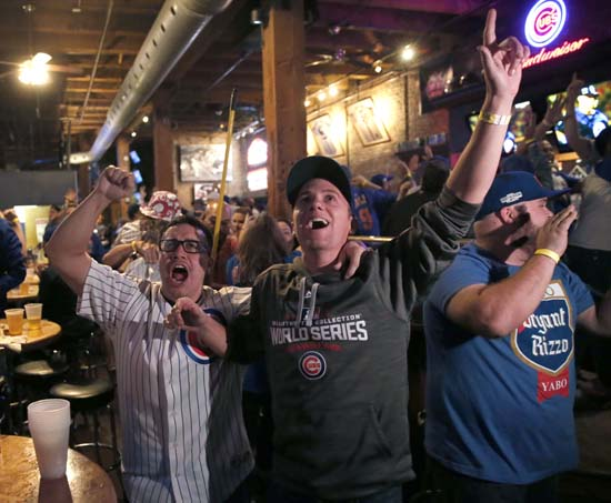 <div class='meta'><div class='origin-logo' data-origin='AP'></div><span class='caption-text' data-credit='AP'>Chicago Cubs fans celebrate at the Cubby Bear bar across the street from Wrigley Field in Chicago after Javier Baez's fifth-inning home run. (AP Photo/Charles Rex Arbogast)</span></div>