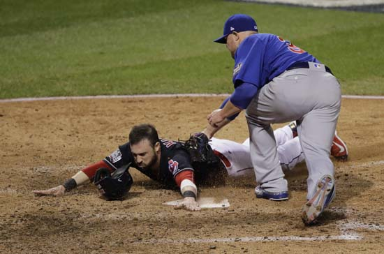 <div class='meta'><div class='origin-logo' data-origin='AP'></div><span class='caption-text' data-credit='AP'>Cleveland Indians' Jason Kipnis scores past Chicago Cubs' Jon Lester during the fifth inning of Game 7. (AP Photo/Gene J. Puskar)</span></div>