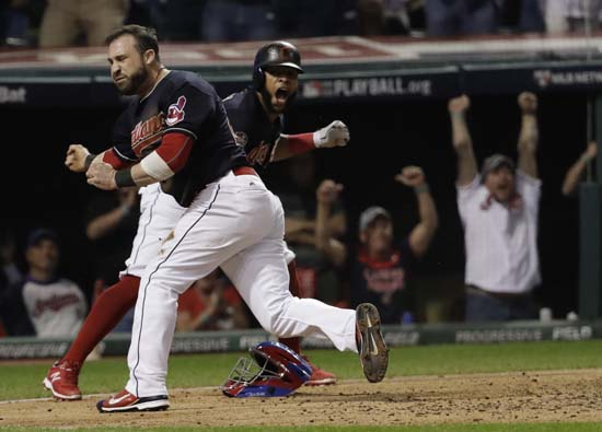 <div class='meta'><div class='origin-logo' data-origin='AP'></div><span class='caption-text' data-credit='AP'>Cleveland Indians' Jason Kipnis and Carlos Santana celebrate after scoring during the fifth inning of Game 7. (AP Photo/David J. Phillip)</span></div>