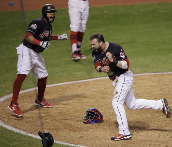 <div class='meta'><div class='origin-logo' data-origin='AP'></div><span class='caption-text' data-credit='AP'>Cleveland Indians' Jason Kipnis and Carlos Santana celebrate after scoring during the fifth inning of Game 7. (AP Photo/Gene J. Puskar)</span></div>