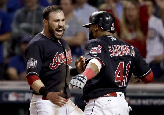 <div class='meta'><div class='origin-logo' data-origin='AP'></div><span class='caption-text' data-credit='AP'>Cleveland Indians' Jason Kipnis, left, celebrates after scoring with Carlos Santana against the Chicago Cubs during the fifth inning of Game 7. (AP Photo/Matt Slocum)</span></div>