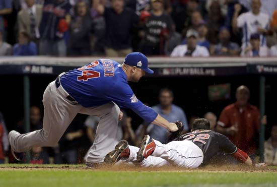 <div class='meta'><div class='origin-logo' data-origin='AP'></div><span class='caption-text' data-credit='AP'>Cleveland Indians' Jason Kipnis, right, scores past Chicago Cubs pitcher Jon Lester during the fifth inning of Game 7. (AP Photo/Matt Slocum)</span></div>