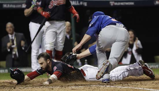 <div class='meta'><div class='origin-logo' data-origin='AP'></div><span class='caption-text' data-credit='AP'>Cleveland Indians' Jason Kipnis scores past Chicago Cubs' Jon Lester during the fifth inning of Game 7 of the Major League Baseball World Series. (AP Photo/David J. Phillip)</span></div>