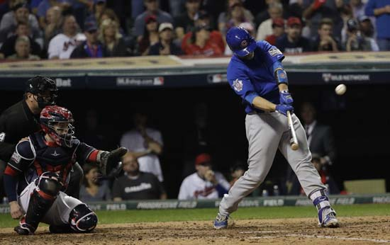 <div class='meta'><div class='origin-logo' data-origin='AP'></div><span class='caption-text' data-credit='AP'>Chicago Cubs' David Ross hits a home run during the sixth inning of Game 7 of the Major League Baseball World Series. (AP Photo/David J. Phillip)</span></div>
