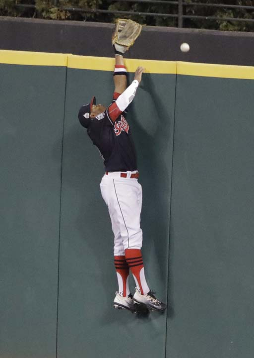 <div class='meta'><div class='origin-logo' data-origin='AP'></div><span class='caption-text' data-credit='AP'>Cleveland Indians' Rajai Davis can't catch a home run hit by Chicago Cubs' David Ross during the sixth inning of Game 7. (AP Photo/Gene J. Puskar)</span></div>