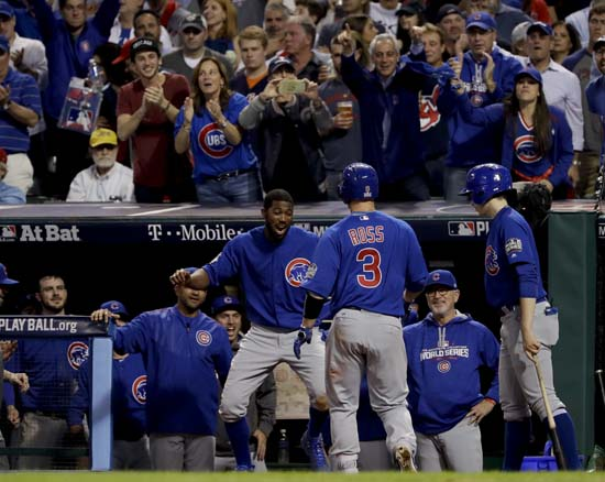 <div class='meta'><div class='origin-logo' data-origin='AP'></div><span class='caption-text' data-credit='AP'>Chicago Cubs' David Ross celebrates in the dugout after a home run against the Cleveland Indians during the sixth inning of Game 7. (AP Photo/Matt Slocum)</span></div>