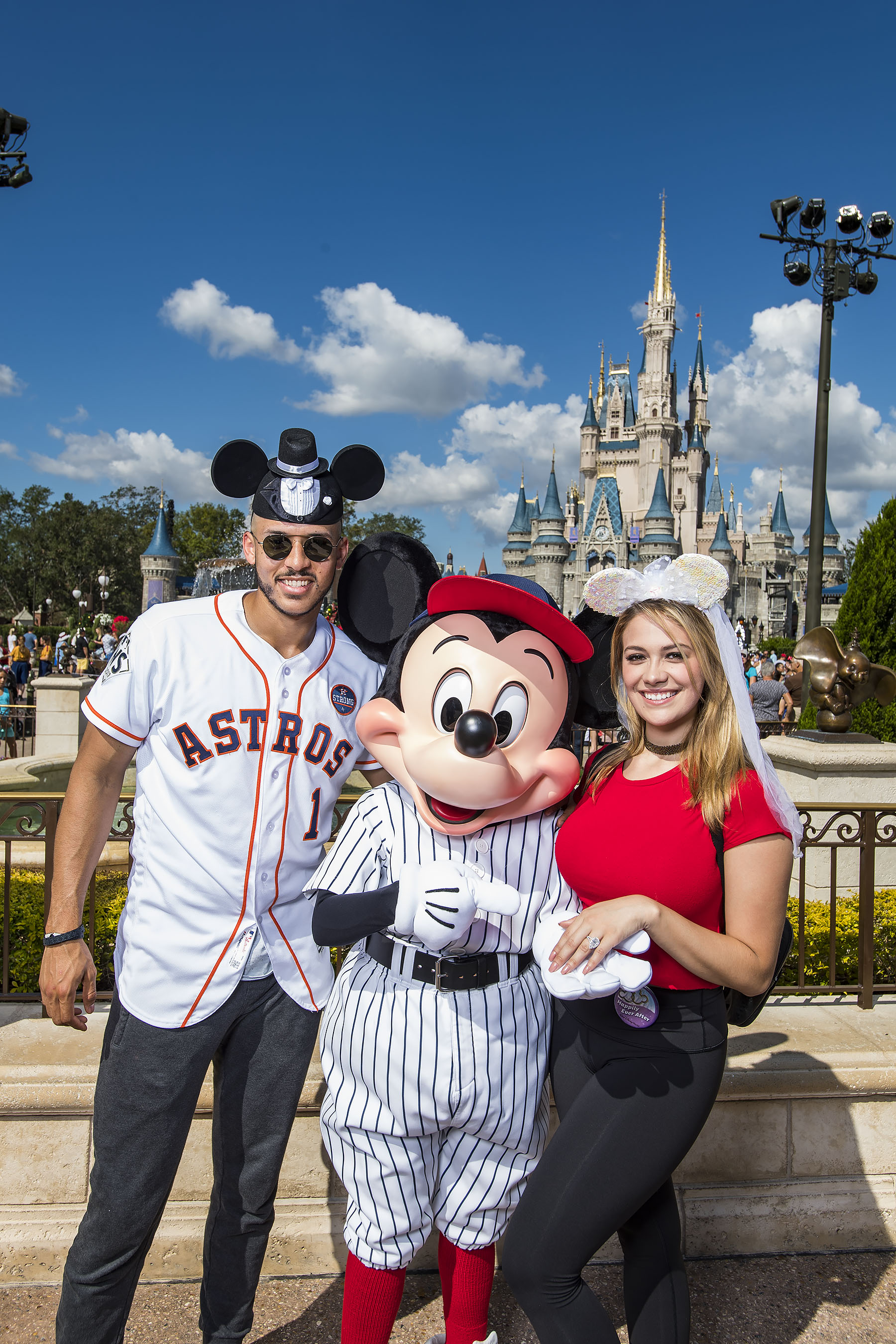 <div class='meta'><div class='origin-logo' data-origin='KTRK'></div><span class='caption-text' data-credit='Matt Stroshane'>Mickey Mouse welcomes newly engaged Houston Astros All-Star Carlos Correa and his fiancŽe Daniella Rodriguez to Walt Disney World Resort in Lake Buena Vista, Fla.</span></div>