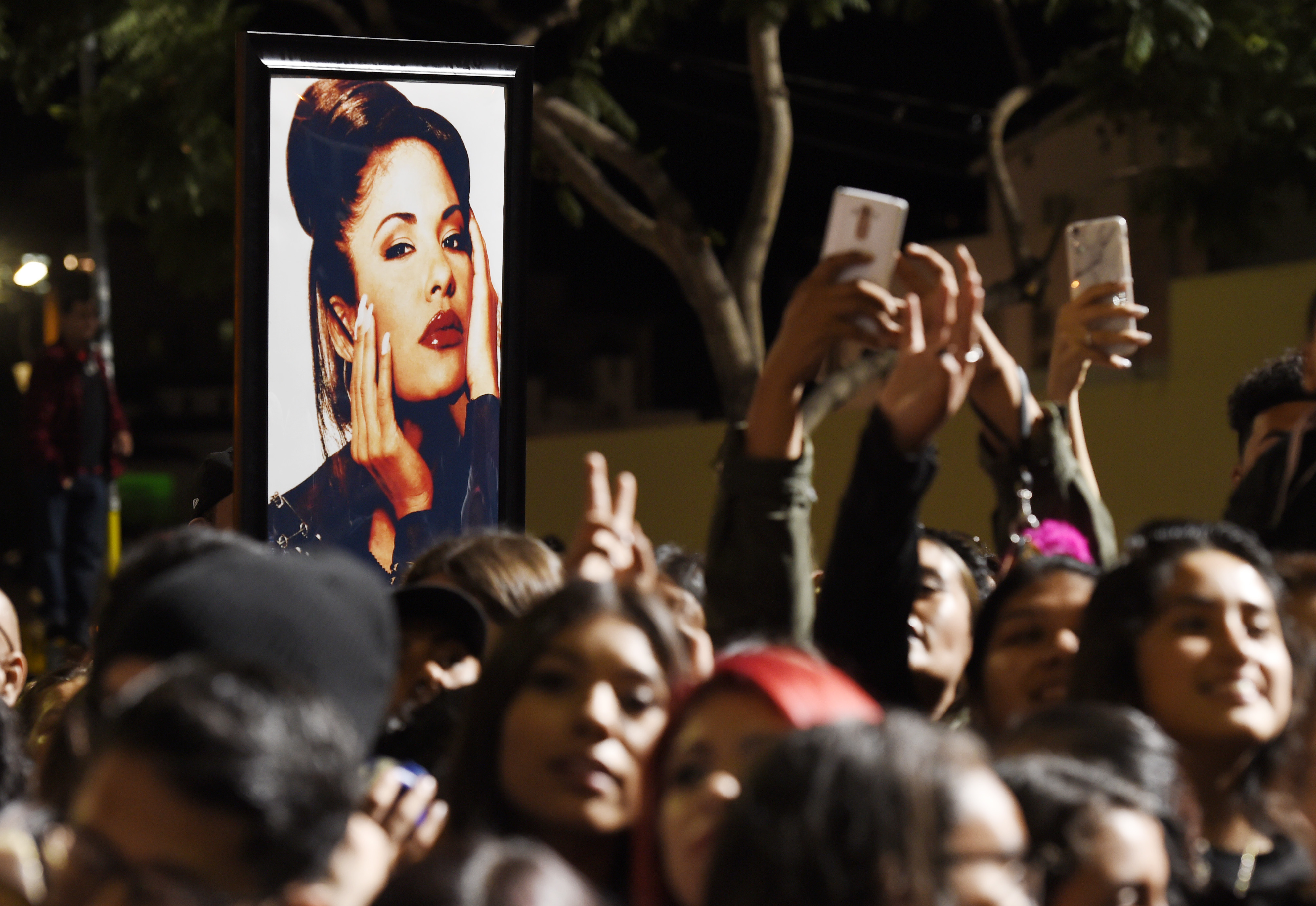 <div class='meta'><div class='origin-logo' data-origin='none'></div><span class='caption-text' data-credit='Chris Pizzello/Invision/AP'>A portrait of the late singer Selena Quintanilla is seen in the crowd following a posthumous star ceremony for Quintanilla on the Hollywood Walk of Fame.</span></div>
