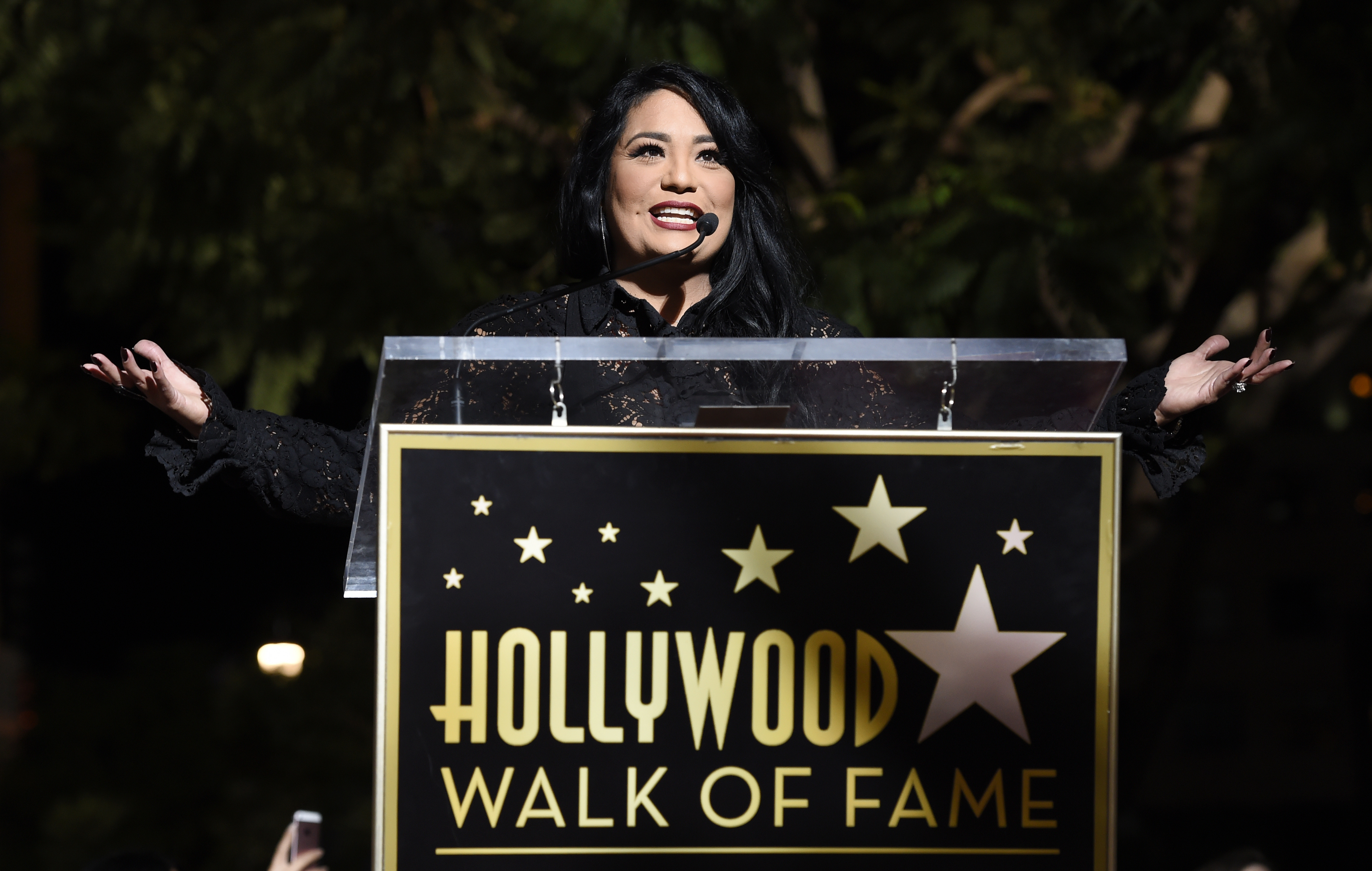 <div class='meta'><div class='origin-logo' data-origin='none'></div><span class='caption-text' data-credit='Chris Pizzello/Invision/AP'>Suzette Quintanilla, sister of the late singer Selena Quintanilla, addresses the crowd during a posthumous star ceremony for Selena on the Hollywood Walk of Fame.</span></div>