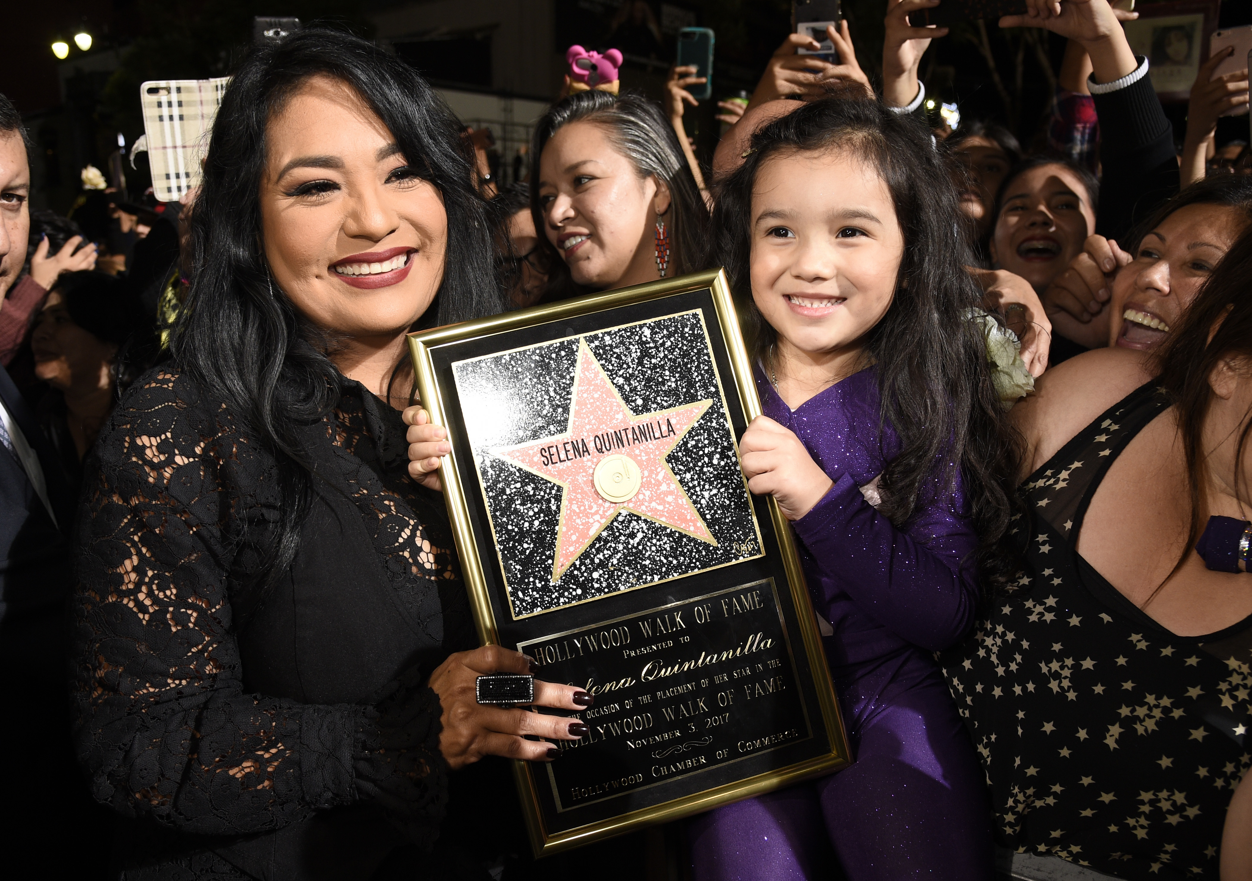 <div class='meta'><div class='origin-logo' data-origin='none'></div><span class='caption-text' data-credit='Chris Pizzello/Invision/AP'>Suzette Quintanilla, left, holds a replica of her sister Selena's star on the Hollywood Walk of Fame as she poses with young fan Sammi Corona-Lampa, 4, of Moreno Valley, Calif.</span></div>