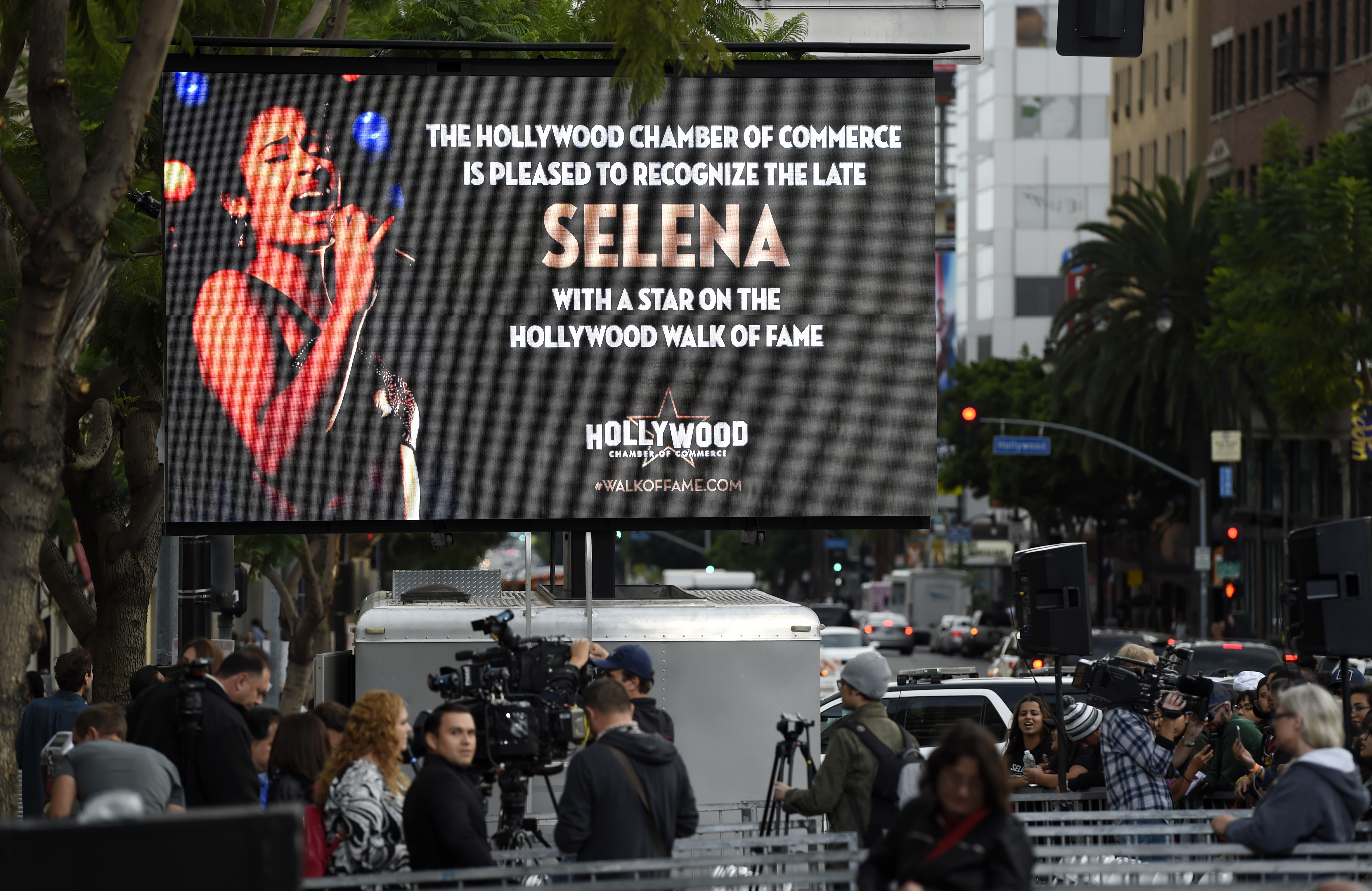 <div class='meta'><div class='origin-logo' data-origin='none'></div><span class='caption-text' data-credit='Chris Pizzello/Invision/AP'>A video screen advertises a ceremony to award the late singer Selena Quintanilla a posthumous star on the Hollywood Walk of Fame on Friday, Nov. 3, 2017, in Los Angeles.</span></div>