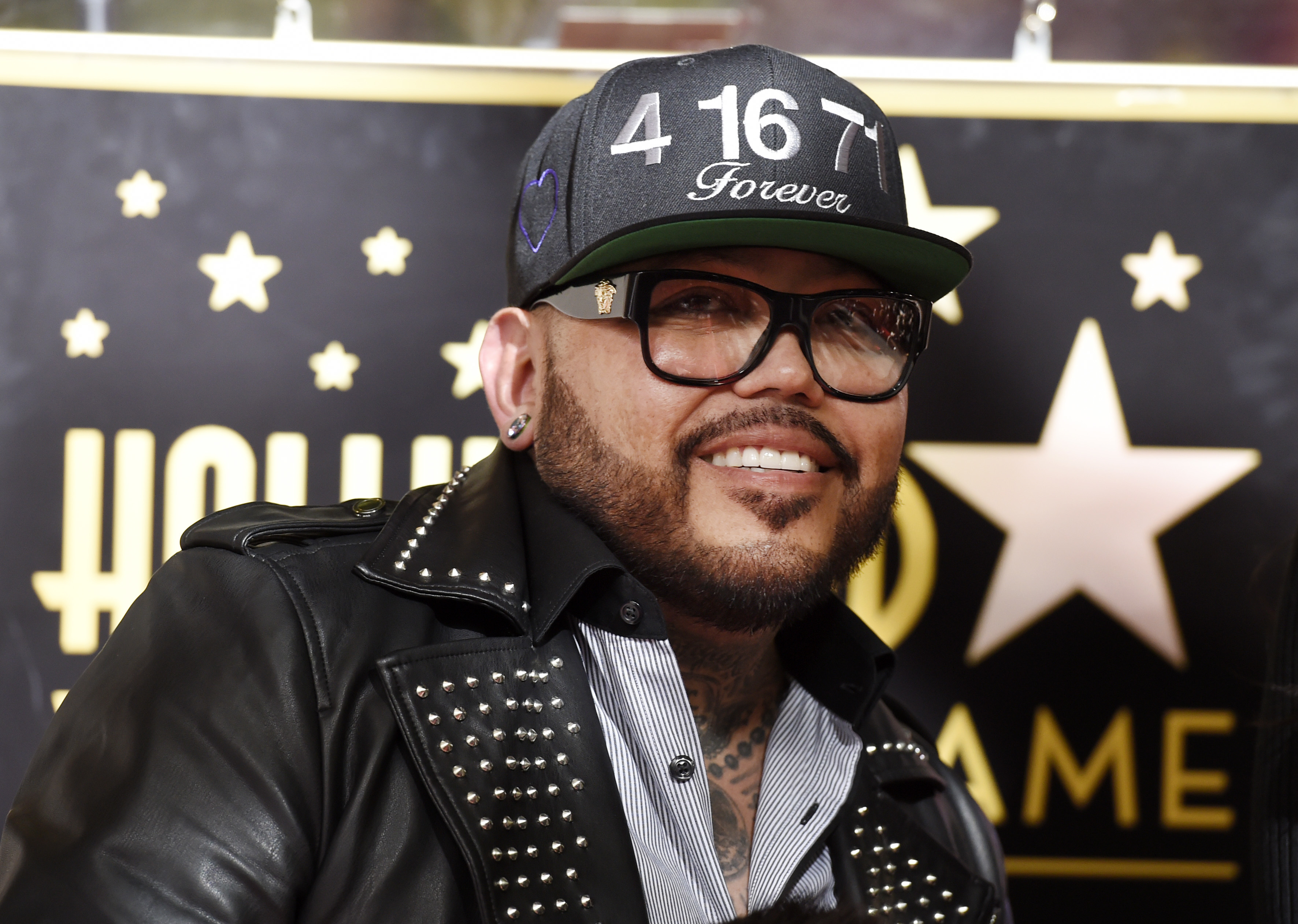 <div class='meta'><div class='origin-logo' data-origin='none'></div><span class='caption-text' data-credit='Chris Pizzello/Invision/AP'>A.B. Quintanilla III, brother of the late singer Selena Quintanilla, poses during a posthumous star ceremony for Selena on the Hollywood Walk of Fame.</span></div>