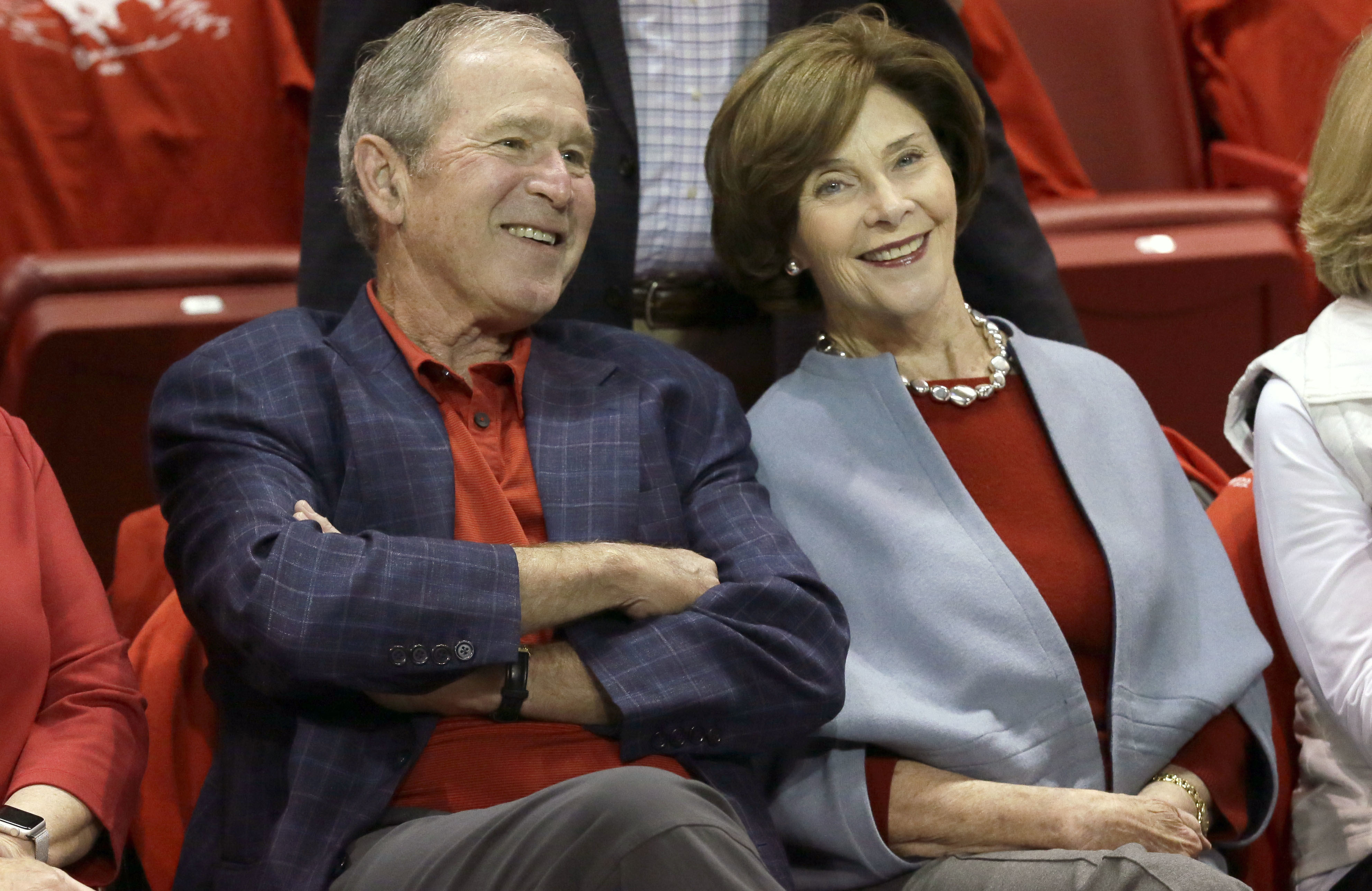 <div class='meta'><div class='origin-logo' data-origin='none'></div><span class='caption-text' data-credit='AP Photo/LM Otero'>Former President George W. Bush, left, sits with his wife Laura Bush before an NCAA college basketball game between SMU and Memphis Saturday, March 4, 2017, in Dallas.</span></div>