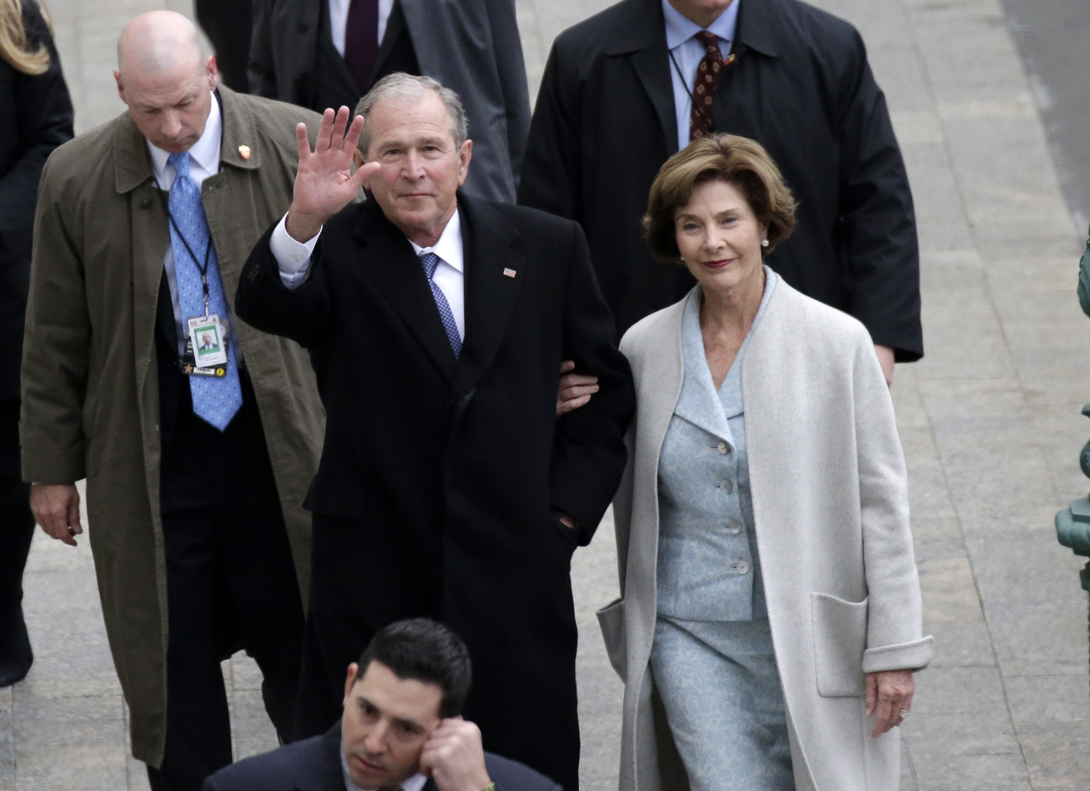 <div class='meta'><div class='origin-logo' data-origin='none'></div><span class='caption-text' data-credit='John Angelillo/Pool Photo via AP'>Former President George W. Bush and wife Laura Bush arrive near the east front steps of the Capitol Building before President-elect Donald Trump is sworn in.</span></div>
