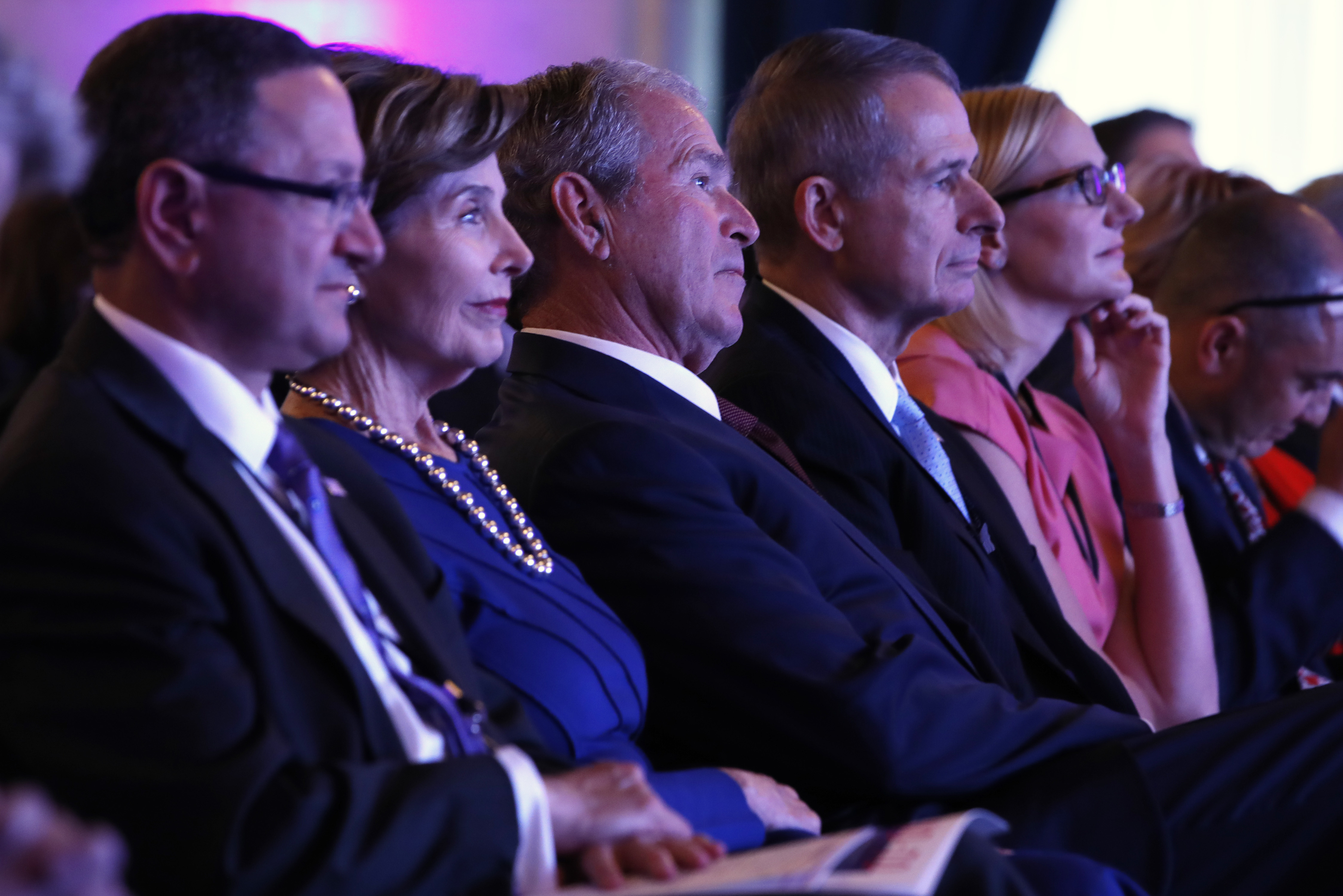 <div class='meta'><div class='origin-logo' data-origin='none'></div><span class='caption-text' data-credit='AP Photo/Jacquelyn Martin'>In the glow of stage lighting, former first lady Laura Bush, second from left, listens with former President George W. Bush, at a summit held by the George W. Bush Institute.</span></div>