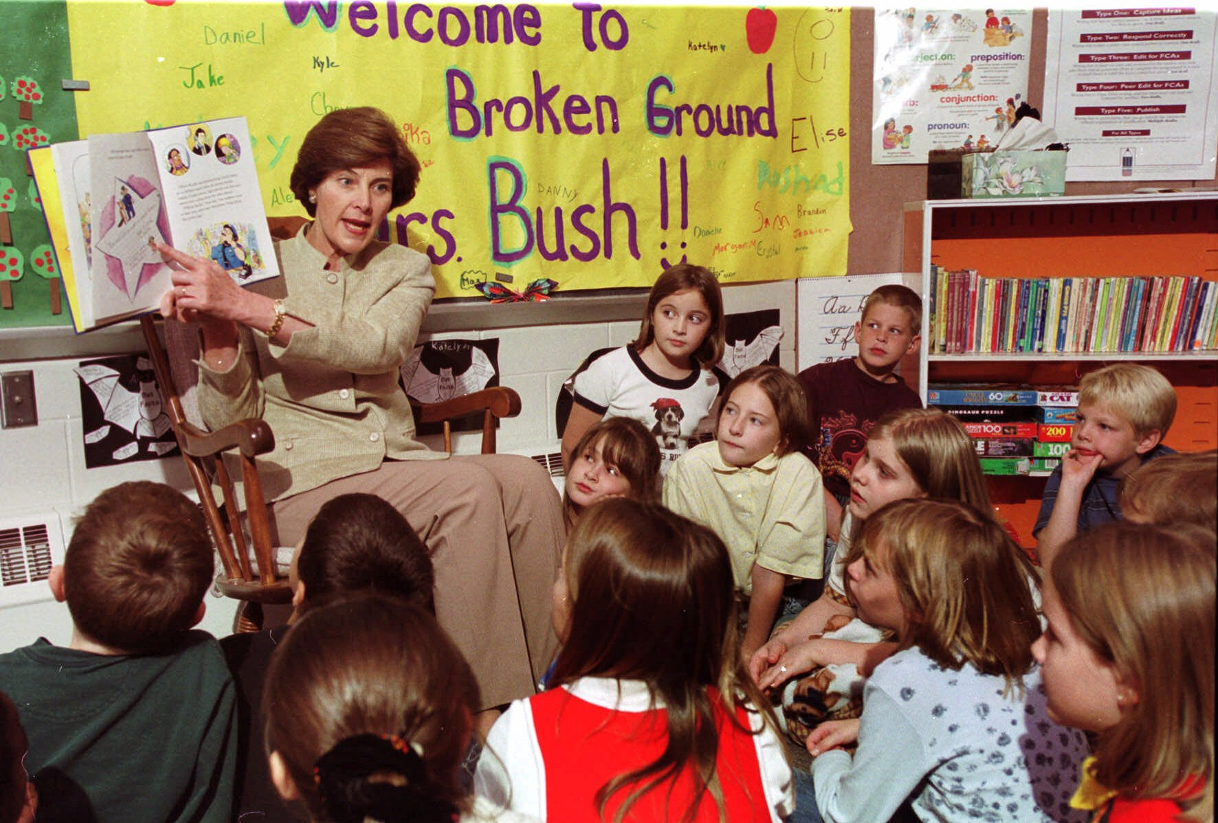 <div class='meta'><div class='origin-logo' data-origin='none'></div><span class='caption-text' data-credit='AP Photo/Jim Cole'>Laura Bush, wife of Republican presidential hopeful Texas Gov. George W. Bush, reads to students at the Broken Ground School in Concord, N.H., Tuesday, Oct. 12, 1999.</span></div>