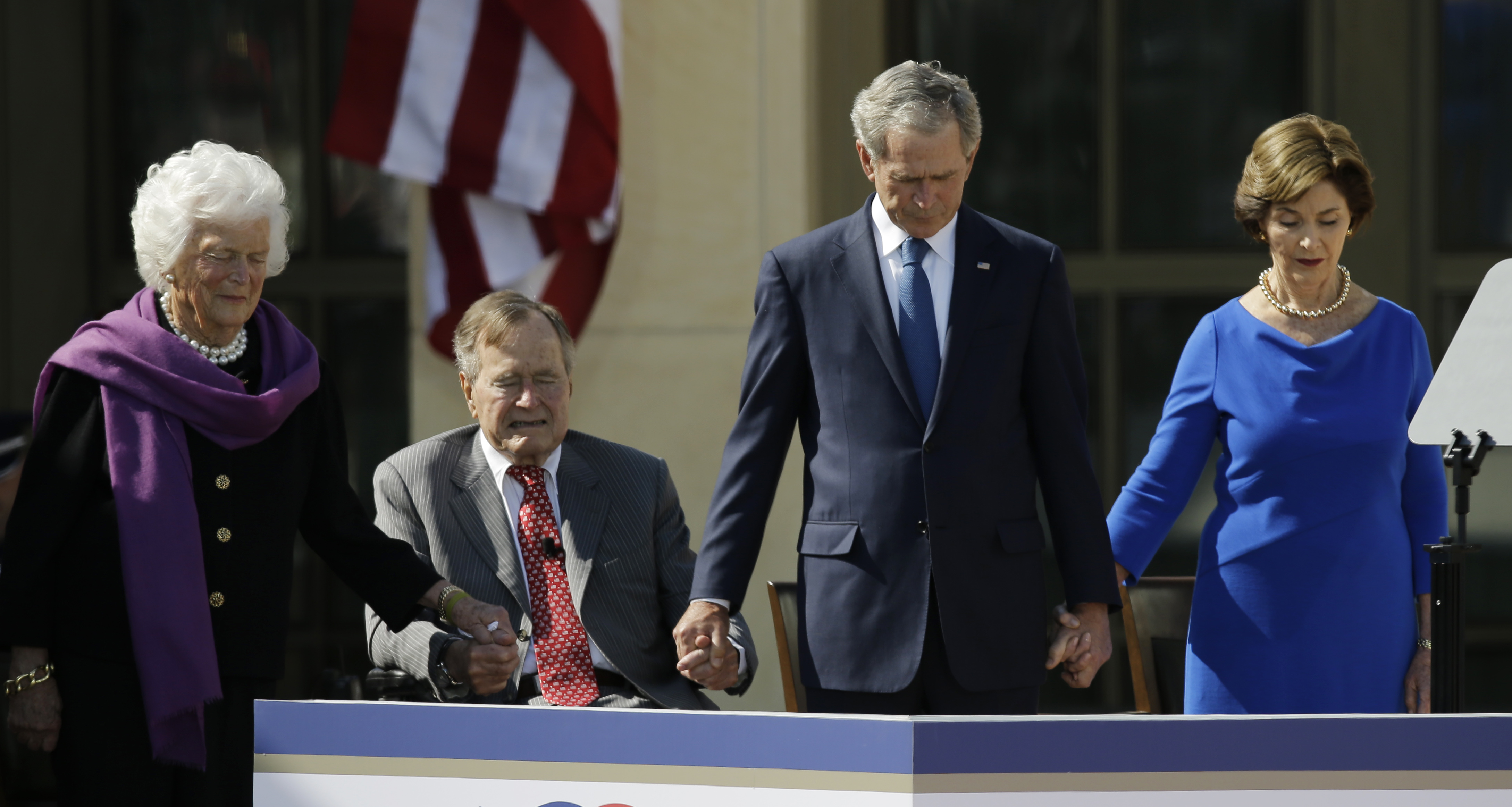 <div class='meta'><div class='origin-logo' data-origin='none'></div><span class='caption-text' data-credit='AP Photo/David J. Phillip'>From left, Barbara Bush, George H.W. Bush, George W. Bush and Laura Bush holds hands during the dedication of the George W. Bush Presidential Center.</span></div>