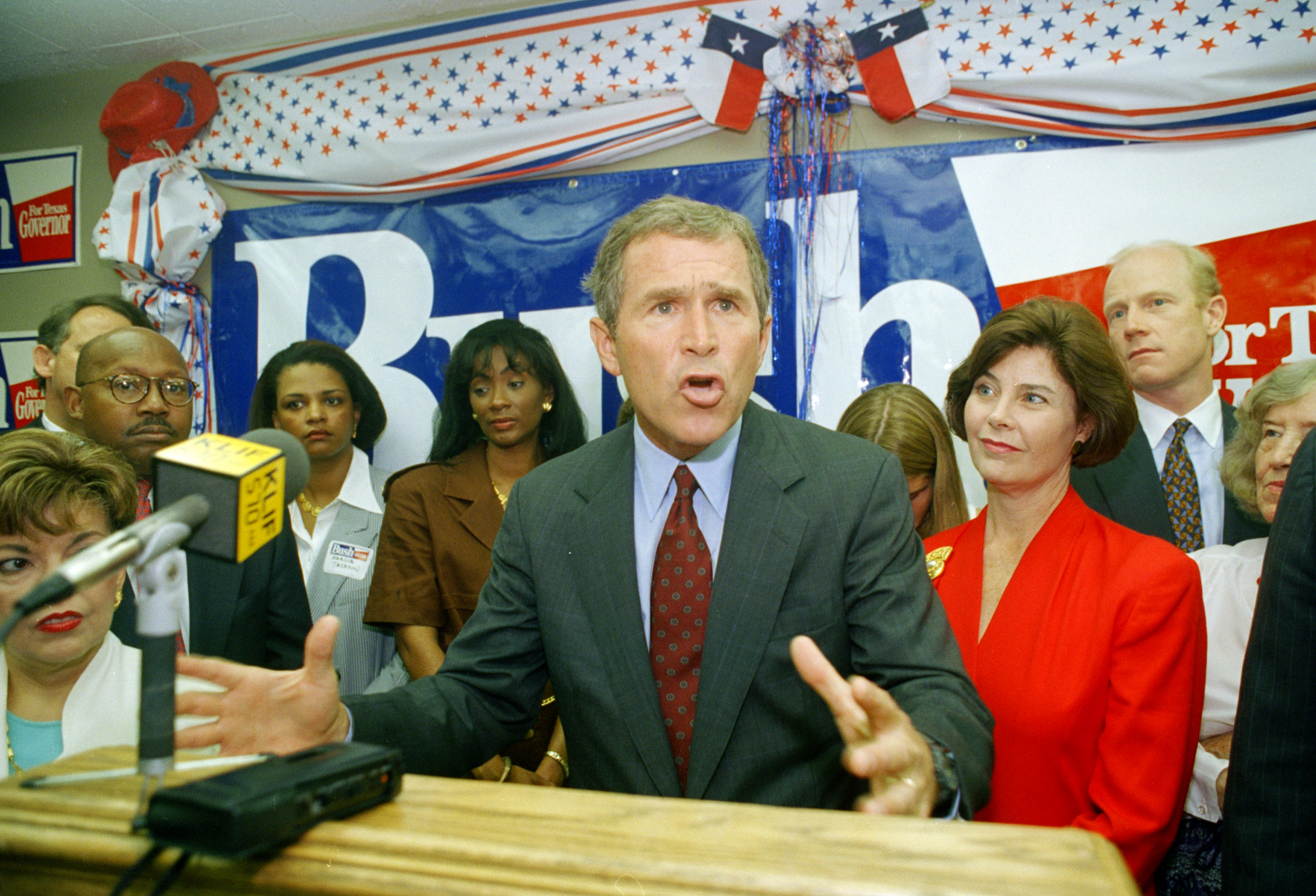 <div class='meta'><div class='origin-logo' data-origin='none'></div><span class='caption-text' data-credit='ASSOCIATED PRESS'>Texas Republican gubernatorial candidate George W. Bush makes a point about Texas prisons as his wife Laura, right, listens during the opening of his Dallas campaign headquarters.</span></div>