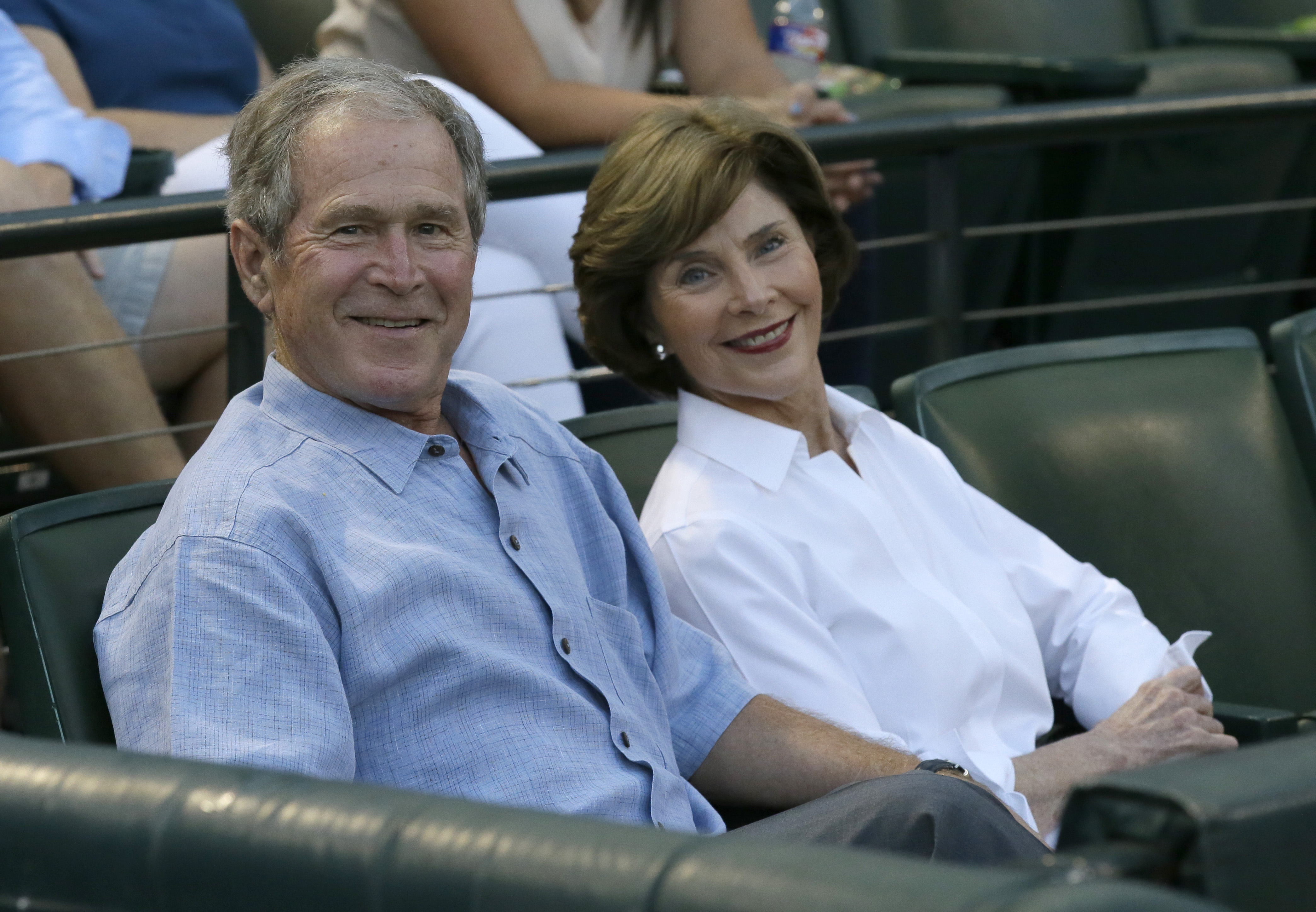 <div class='meta'><div class='origin-logo' data-origin='none'></div><span class='caption-text' data-credit='AP Photo/LM Otero'>Former President George Bush, left, smiles with his wife Laura Bush before a baseball game between the Seattle Mariners and Texas Rangers in Arlington, Texas.</span></div>