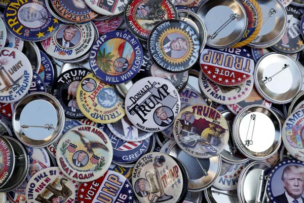 <div class='meta'><div class='origin-logo' data-origin='AP'></div><span class='caption-text' data-credit='AP Photo/John Minchillo'>Buttons supporting Republican presidential candidate Donald Trump are on display</span></div>