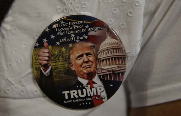 <div class='meta'><div class='origin-logo' data-origin='AP'></div><span class='caption-text' data-credit='AP Photo/Ted S. Warren'>A supporter of Republican presidential candidate Donald Trump wears a button</span></div>