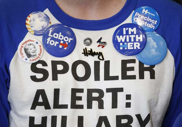 <div class='meta'><div class='origin-logo' data-origin='AP'></div><span class='caption-text' data-credit='AP Photo/John Locher'>A man wears buttons in support of Democratic presidential candidate Hillary Clinton</span></div>