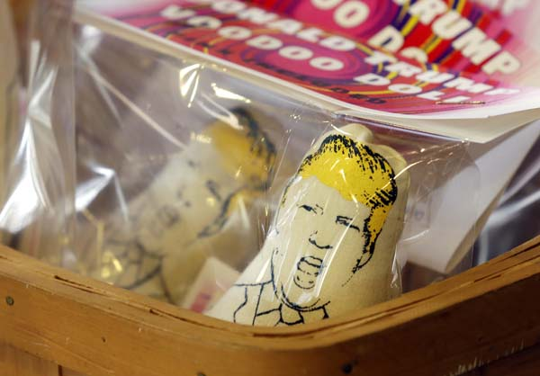 <div class='meta'><div class='origin-logo' data-origin='AP'></div><span class='caption-text' data-credit='AP Photo/Ted S. Warren'>Donald Trump voodoo dolls are offered for sale</span></div>