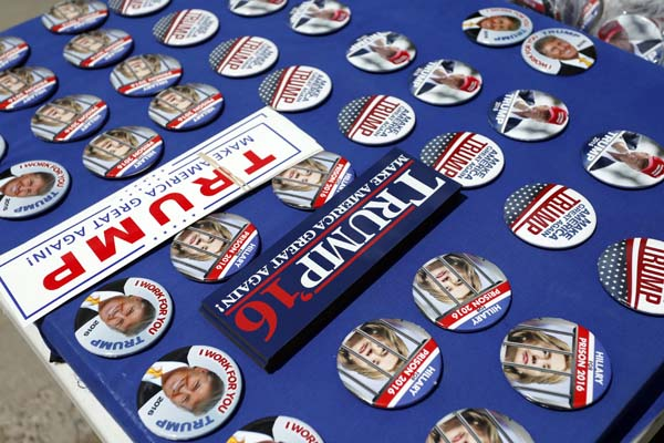 <div class='meta'><div class='origin-logo' data-origin='AP'></div><span class='caption-text' data-credit='AP Photo/Brennan Linsley'>Buttons and stickers for sale before a campaign event with Republican presidential candidate Donald Trump</span></div>