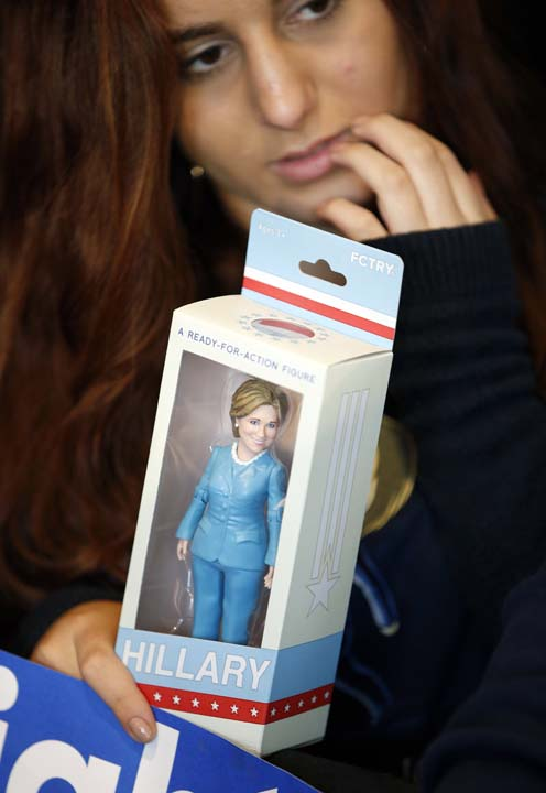 <div class='meta'><div class='origin-logo' data-origin='AP'></div><span class='caption-text' data-credit='AP Photo/John Locher'>A woman holds a doll of Democratic presidential candidate Hillary Clinton before a rally</span></div>