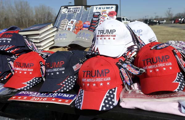 <div class='meta'><div class='origin-logo' data-origin='AP'></div><span class='caption-text' data-credit='AP Photo/Elise Amendola'>ampaign hats, books, buttons and bumper stickers for Republican presidential candidate Donald Trump</span></div>