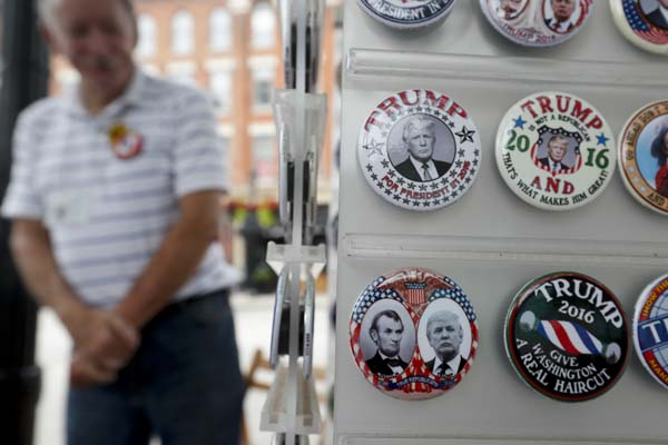 <div class='meta'><div class='origin-logo' data-origin='AP'></div><span class='caption-text' data-credit='AP Photo/Alex Brandon'>Bob Alexander poses with his custom campaign buttons for Republican presidential candidate Donald Trump</span></div>