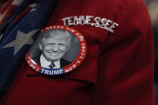 <div class='meta'><div class='origin-logo' data-origin='AP'></div><span class='caption-text' data-credit='AP Photo/Mary Altaffer'>A delegate from Tenessee wears a Republican button</span></div>