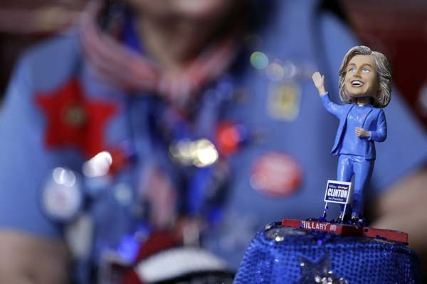 <div class='meta'><div class='origin-logo' data-origin='AP'></div><span class='caption-text' data-credit='AP Photo/John Locher'>A delegate wears a hat with a bubble-head doll of Democratic Presidential candidate Sec. Hillary Clinton</span></div>