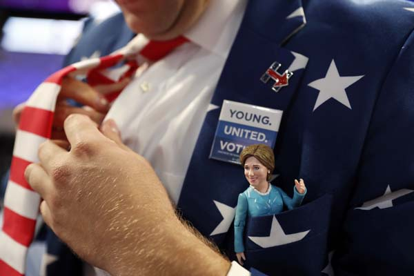 <div class='meta'><div class='origin-logo' data-origin='AP'></div><span class='caption-text' data-credit='AP Photo/Carolyn Kaster'>Virginia delegate Morgan Jameson puts on a tie as he shows off a Hillary Clinton doll on his chest pocket</span></div>