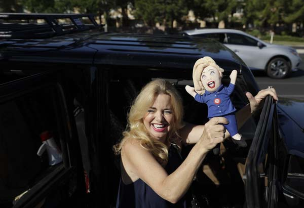 <div class='meta'><div class='origin-logo' data-origin='AP'></div><span class='caption-text' data-credit='AP Photo/John Locher'>Donald Trump supporter Mona Lidji Fishman waves around a Hillary Clinton doll</span></div>