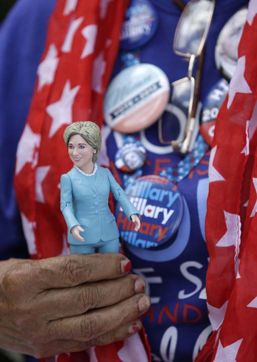 <div class='meta'><div class='origin-logo' data-origin='AP'></div><span class='caption-text' data-credit='AP Photo/Wilfredo Lee'>Maria Mendoza holds a Hillary Clinton doll as she waits in line to attend a rally for the Democratic presidential candidate</span></div>