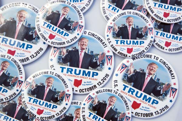 <div class='meta'><div class='origin-logo' data-origin='AP'></div><span class='caption-text' data-credit='AP Photo/John Minchillo'>Campaign buttons in support of Republican presidential candidate Donald Trump</span></div>