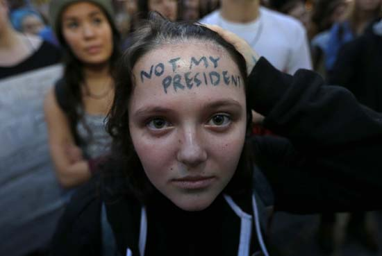 <div class='meta'><div class='origin-logo' data-origin='AP'></div><span class='caption-text' data-credit='Ted S. Warren'>Clair Sheehan has the words &#34;Not My President&#34; written on her forehead as she takes part in a protest in downtown Seattle.</span></div>