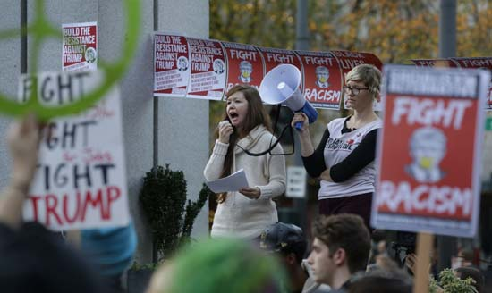<div class='meta'><div class='origin-logo' data-origin='AP'></div><span class='caption-text' data-credit='AP'>Protesters yell during a protest against the election of President-elect Donald Trump, Wednesday, Nov. 9, 2016, in downtown Seattle. (AP Photo/Ted S. Warren)</span></div>