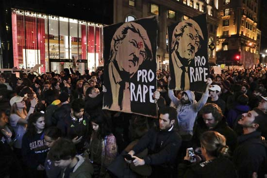<div class='meta'><div class='origin-logo' data-origin='AP'></div><span class='caption-text' data-credit='Julie Jacobson'>Protesters march along Fifth Avenue outside Trump Tower, Wednesday, Nov. 9, 2016, in New York, in opposition of Donald Trump's presidential election victory.</span></div>