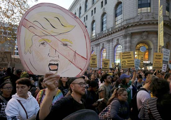 <div class='meta'><div class='origin-logo' data-origin='AP'></div><span class='caption-text' data-credit='AP'>Protesters hold up signs during a demonstration in opposition of Donald Trump's presidential election victory in San Francisco, Wednesday, Nov. 9, 2016. (AP Photo/Jeff Chiu)</span></div>