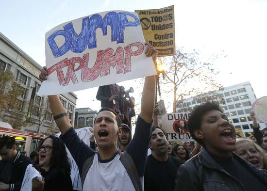 <div class='meta'><div class='origin-logo' data-origin='AP'></div><span class='caption-text' data-credit='AP'>Ryan Restauro, left, and other protesters yell in opposition of Donald Trump's presidential election victory in San Francisco, Wednesday, Nov. 9, 2016. (AP Photo/Jeff Chiu)</span></div>